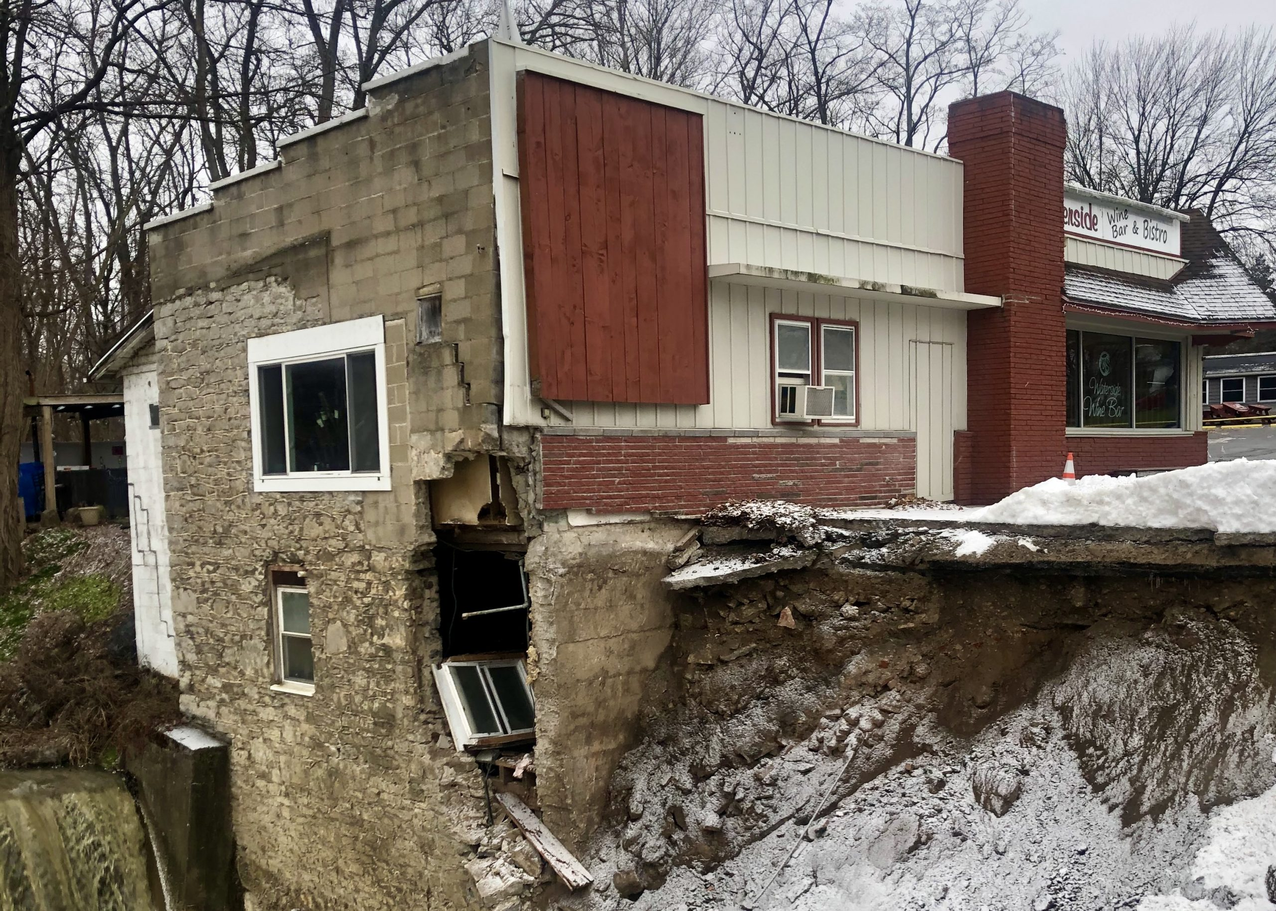 Phelps business owner looks forward after part of building, parking lot crumbles into Flint Creek